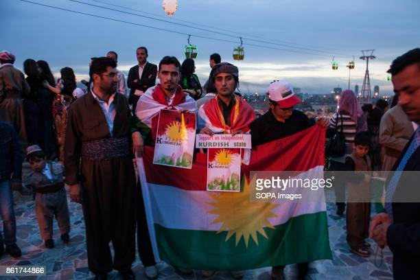 Young Kurdish men are seen holding a flag of Kurdistan during the Nowruz Festival Nowruz means a 'new day daylight' is the traditional Kurdish...