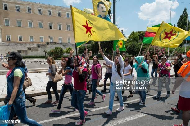 Young Kurdish women hold flags of KCK YPG and Rojava and as they demonstrate in front of the Greek parliament in Athens on July 16 2015 The United...