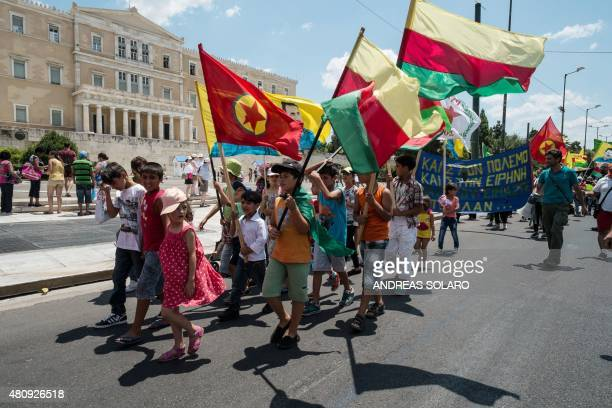 Young Kurds hold flags of PKK and Rojava as they demonstrate in front of the Greek parliament in Athens on July 16 2015 The United States does not...