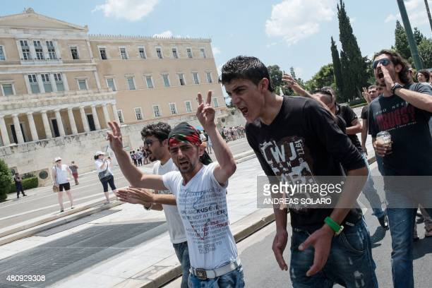 Young Kurds shout slougan as they demonstrate in front of the Greek parliament in Athens on July 16 2015 The United States does not support the...