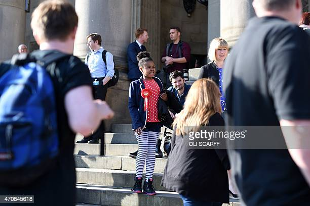A young Labour Party supporter stands on the steps of Leeds Town Hall as she waits to attend a rally where opposition Labour Party leader Ed Miliband...
