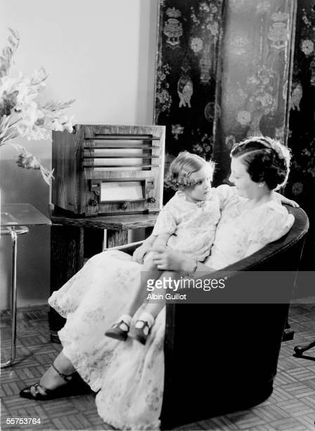 Young lady and her daughter listening to the radio about 1930 RV25872