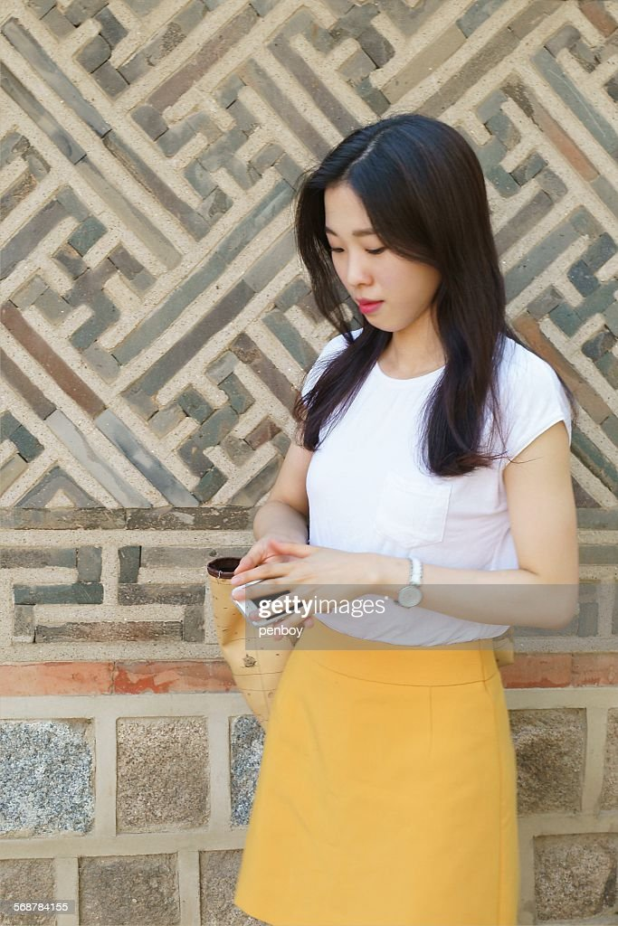 A Young lady and traditional patterns : Stock Photo