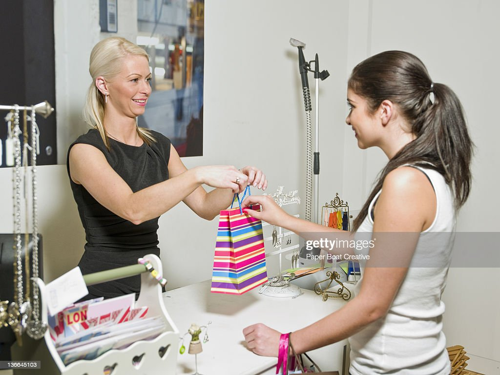 young lady buying jewelry in a shop : Stock Photo