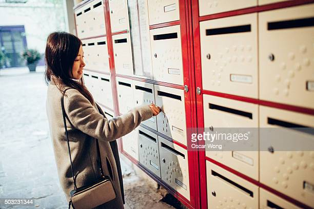 Young lady checking mailbox