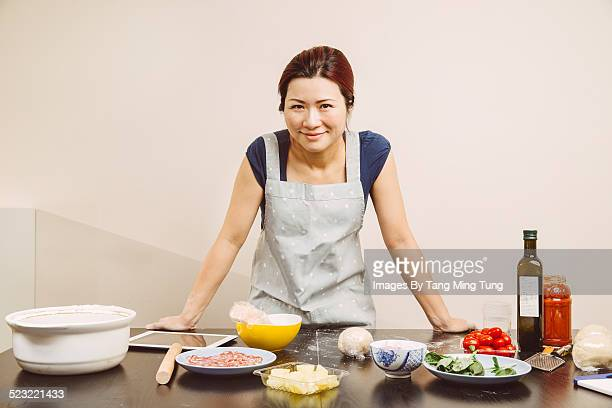 Young lady chef looking at camera smiling