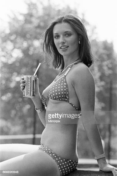 Young lady cools down with a refreshment as she enjoys the summer heatwave Teesside Circa August 1976
