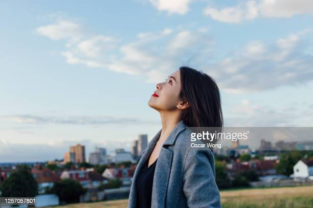 young lady embracing hope and freedom - businesswoman stock pictures, royalty-free photos & images