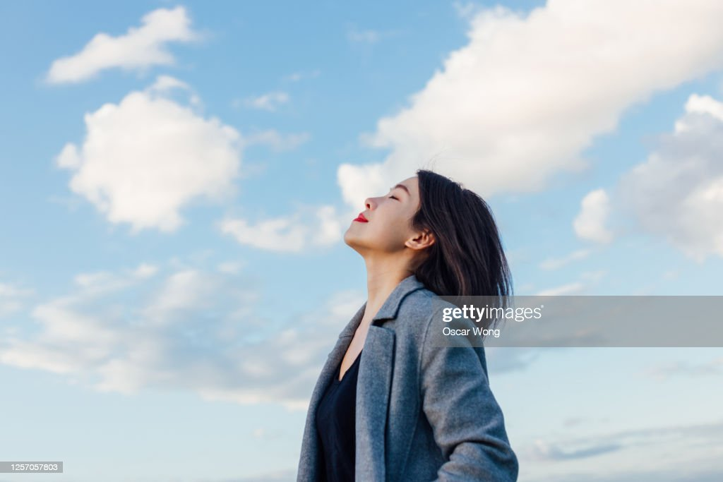 Young Lady Embracing Hope And Freedom : Photo