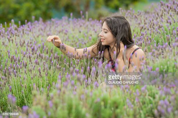 a young lady enjoy the lavender field before the storm - claudio capucho stock pictures, royalty-free photos & images