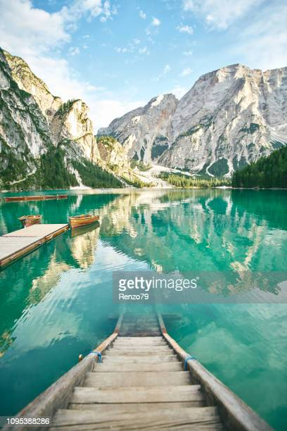 young lady enjoy the nature at a beautiful lake . - pragser wildsee stock pictures, royalty-free photos & images