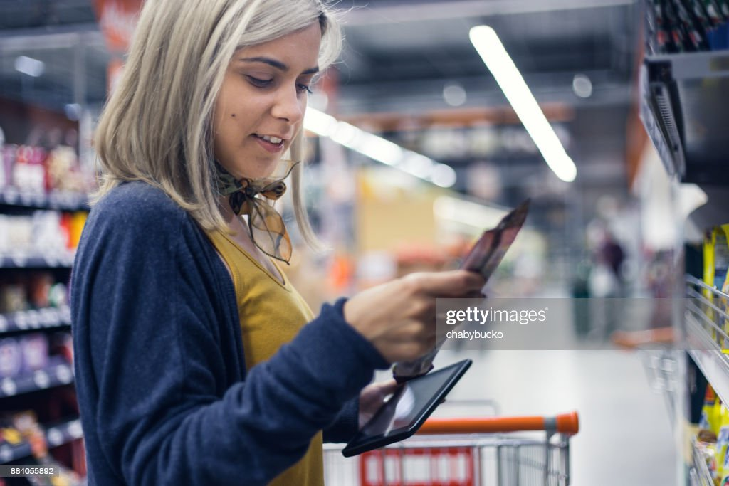 Young lady groceries shopping : Stock Photo