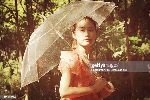 A young lady hit umbrella in the park