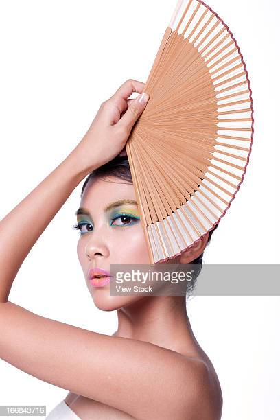 Young lady holding fan