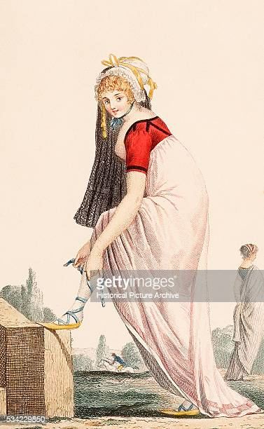 A young lady in a Grecianstyle Empire line summer outfit with espadrilles and a veil style headdress