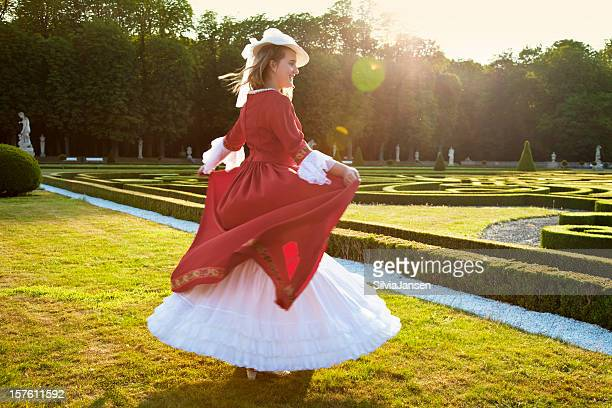young lady in front of baroque garden