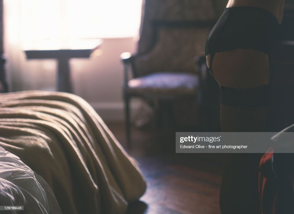 Young lady in room with stockings in leg : Stock Photo