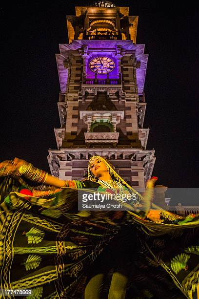 CONTENT] A young lady is performing with Rajasthani folk song under the clock tower during Marwar festival at Jodhpur India She is wearing...