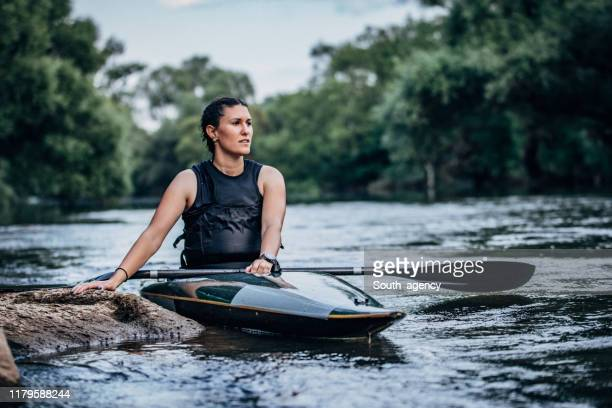 young lady kayaker in river - paddling stock pictures, royalty-free photos & images