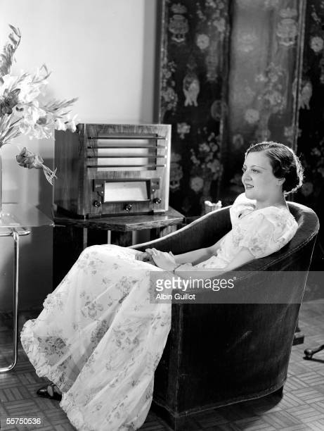 Young lady listening to the radio about 1935 RV25874