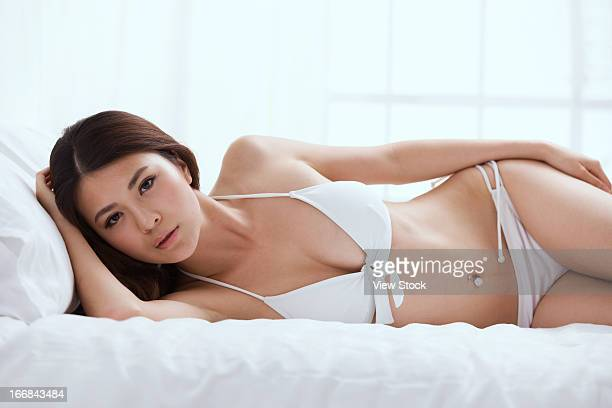 Young lady lying on bed