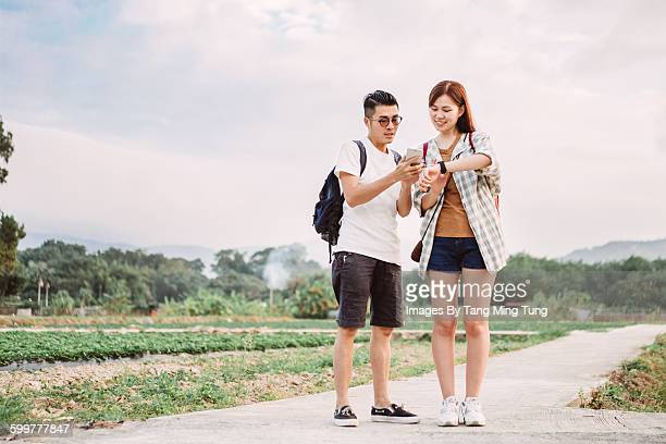 Young lady & man using smartphone & smartwatch