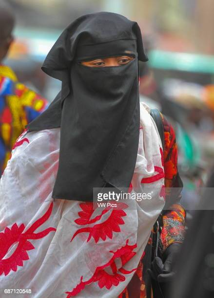 A young lady muslim outfit completely covered from head to foot walking downtown in Bamako the Capital City of Maly/West Africa