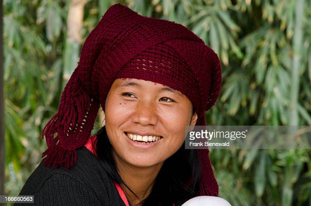Young lady of the Ao tribe on a roadside market near Ungma Village