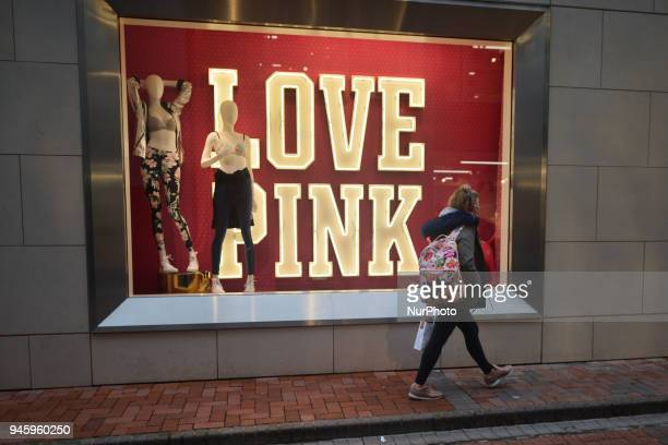A young lady passed near a shop window with 'Love Pint' theme next to Dublin's Grafton Street On Friday April 13 in Dublin Ireland