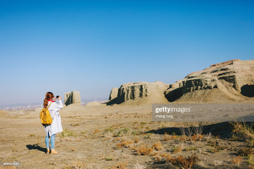 young lady photographer take picture in wild,Xinjiang : Stock Photo