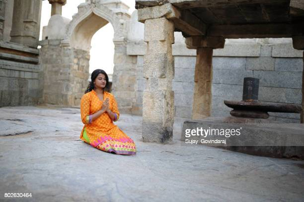 young lady praying to the hindu god - hinduism stock pictures, royalty-free photos & images