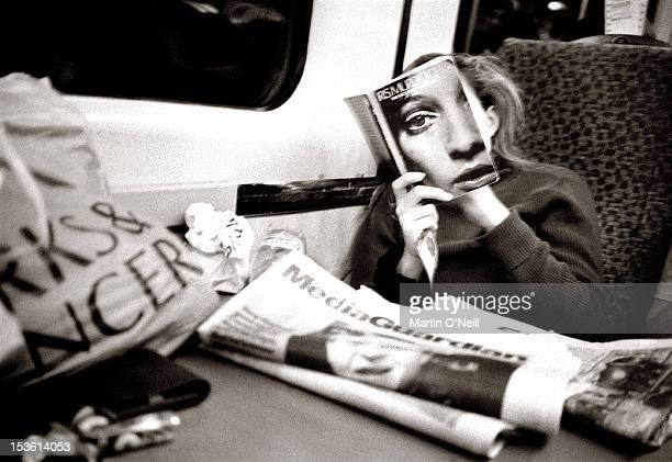 A young lady reads a book on the ManchesterLondon train circa 1983