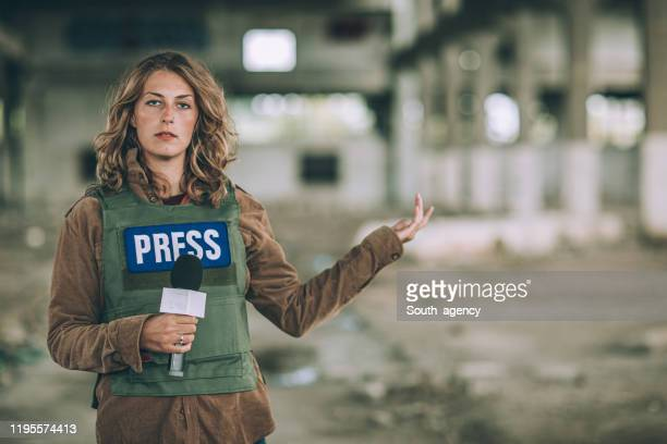 young lady reporting live from the war zone - live event stock pictures, royalty-free photos & images