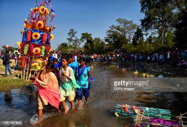 A young lady seen carrying the Chowdal during the festival People from the rural Bengal of India celebrate the Tusu Festival on the day of Makar...