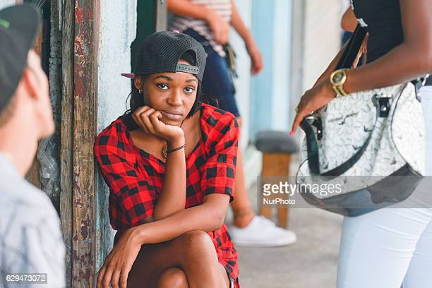 A young lady seen near a local shop entrance in Havana city center For a week I explored the streets of Havana the homes and Havana's vastly diverse...