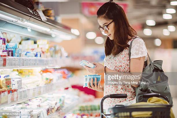 Young lady shopping at supermarket