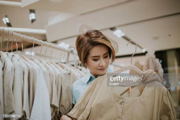 young lady shopping cloth on weekend-stock photo - 30 39 years stock pictures, royalty-free photos & images