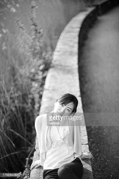 young lady sitting comfortable looking towards lens