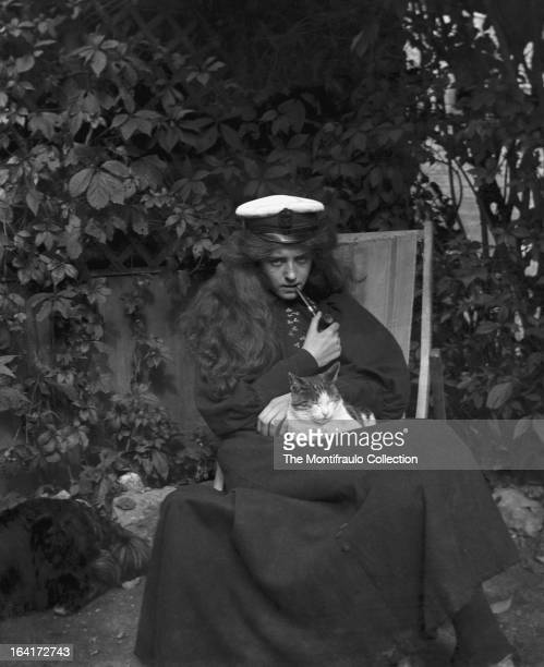 Young lady sitting in a deckchair smoking a pipe England circa 1905