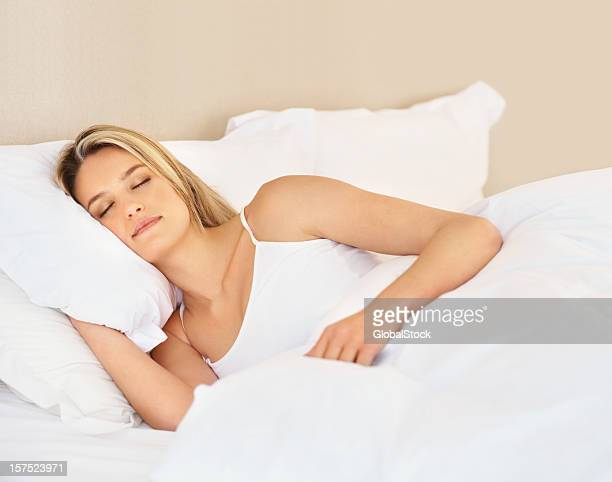 Young lady sleeping in bed