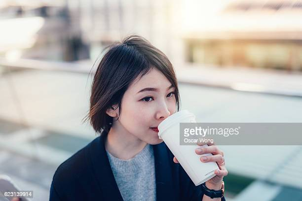 Young lady taking break for a cup of good coffee
