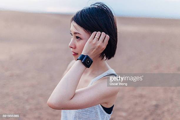 Young lady taking rest after run in desert