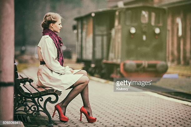 Young lady waiting for a train