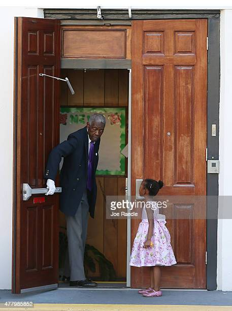 A young lady waits for the doors to open at Emanuel African Methodist Episcopal Church as it is opened for a Sunday service after a mass shooting at...