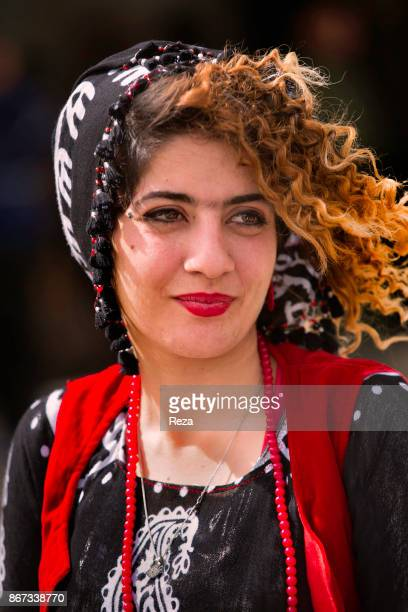 A young lady wearing the traditional Kurdish mariage garb in memory of the victims during a memorial of Halabja on March 16 the commemorative day of...
