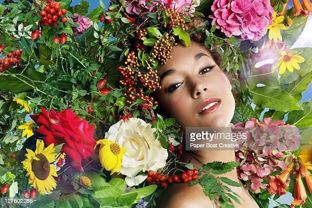 young lady with colorful wild flowers on her head - surrounding stock pictures, royalty-free photos & images