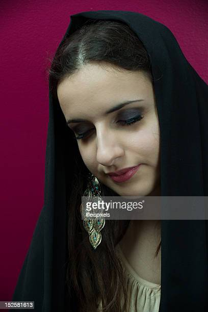 young lady with peacock earring - lifeispixels stock pictures, royalty-free photos & images