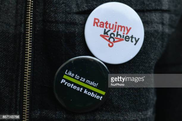 A young lady with two badges 'Let's save women' and 'Like that's too little Women Protest' during Black Tuesday protest in Rzeszow Main Square On the...