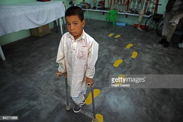 A young landmine victim during a visit to the International Red Cross Orthopedic rehabilitation center on December 10 2009 in Kabul Afghanistan The...