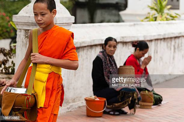 Young Lao Buddhist Monk Passes After Receiving Alms From Lao Buddhist Ladies Making Merit In Luang Prabang Laos